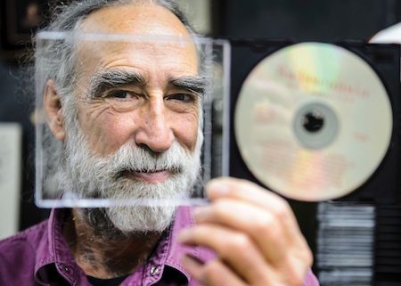 Professor James Leary peers through a CD jewel case.