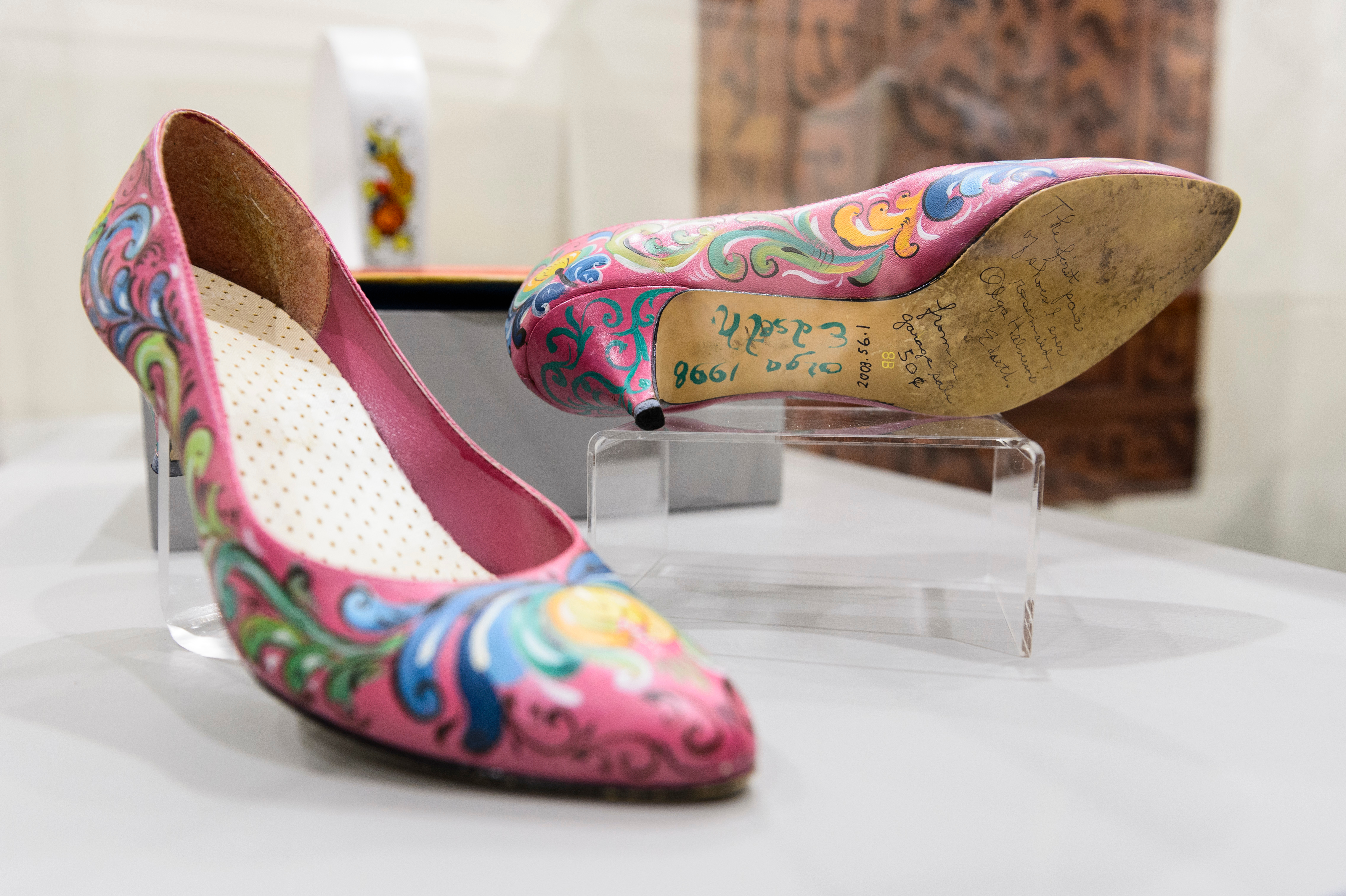 A pair of hot pink pumps rosemaled by Olga Edseth on display at the Driftless Historium in Mt. Horeb, Wisconsin