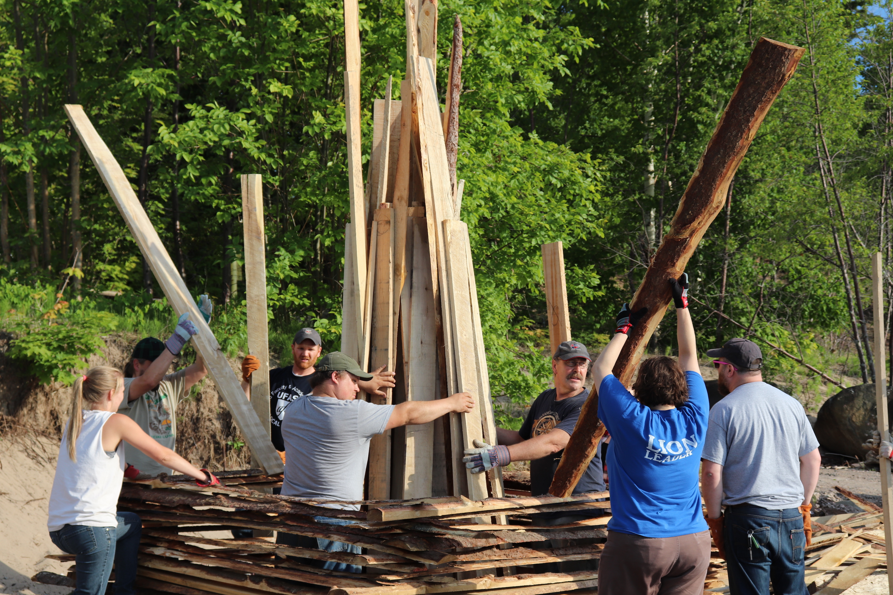 Volunteers continue to build the bonfire