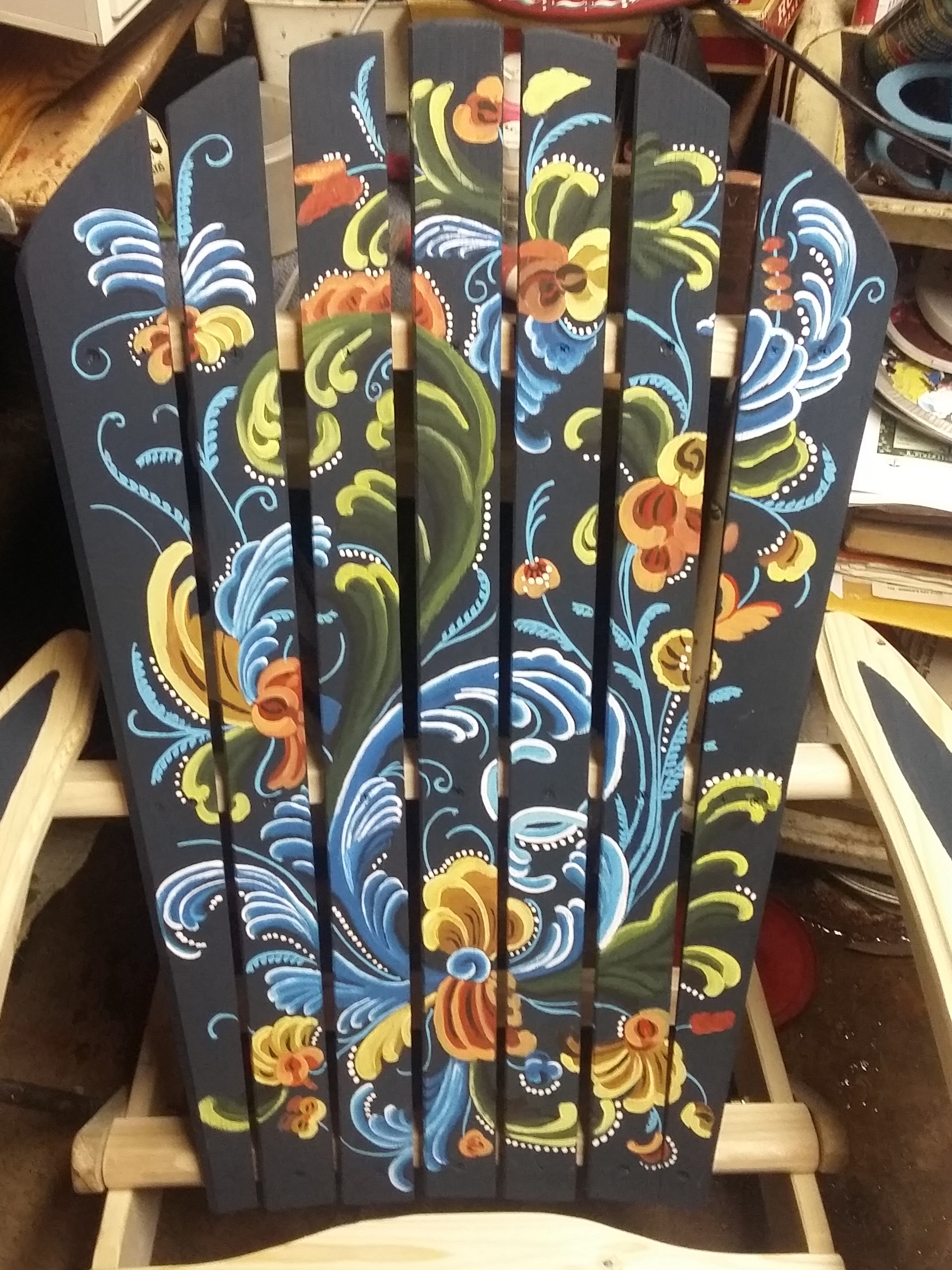 A chair rosemaled by Lisa Severance.