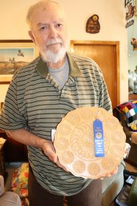 Lowell Anderson with one of his many prize-winning plates