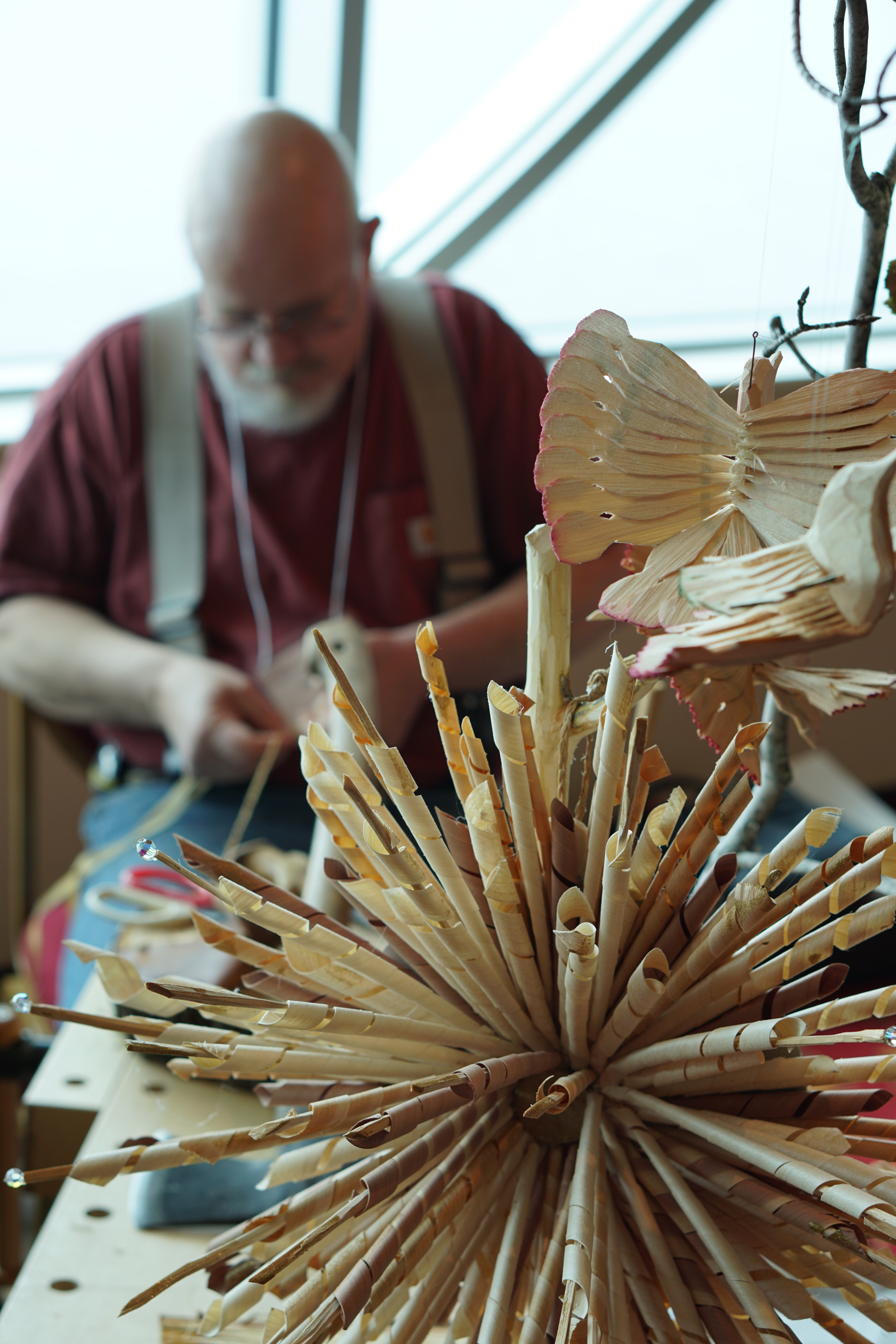 Pekka Olson works on a new wood carving