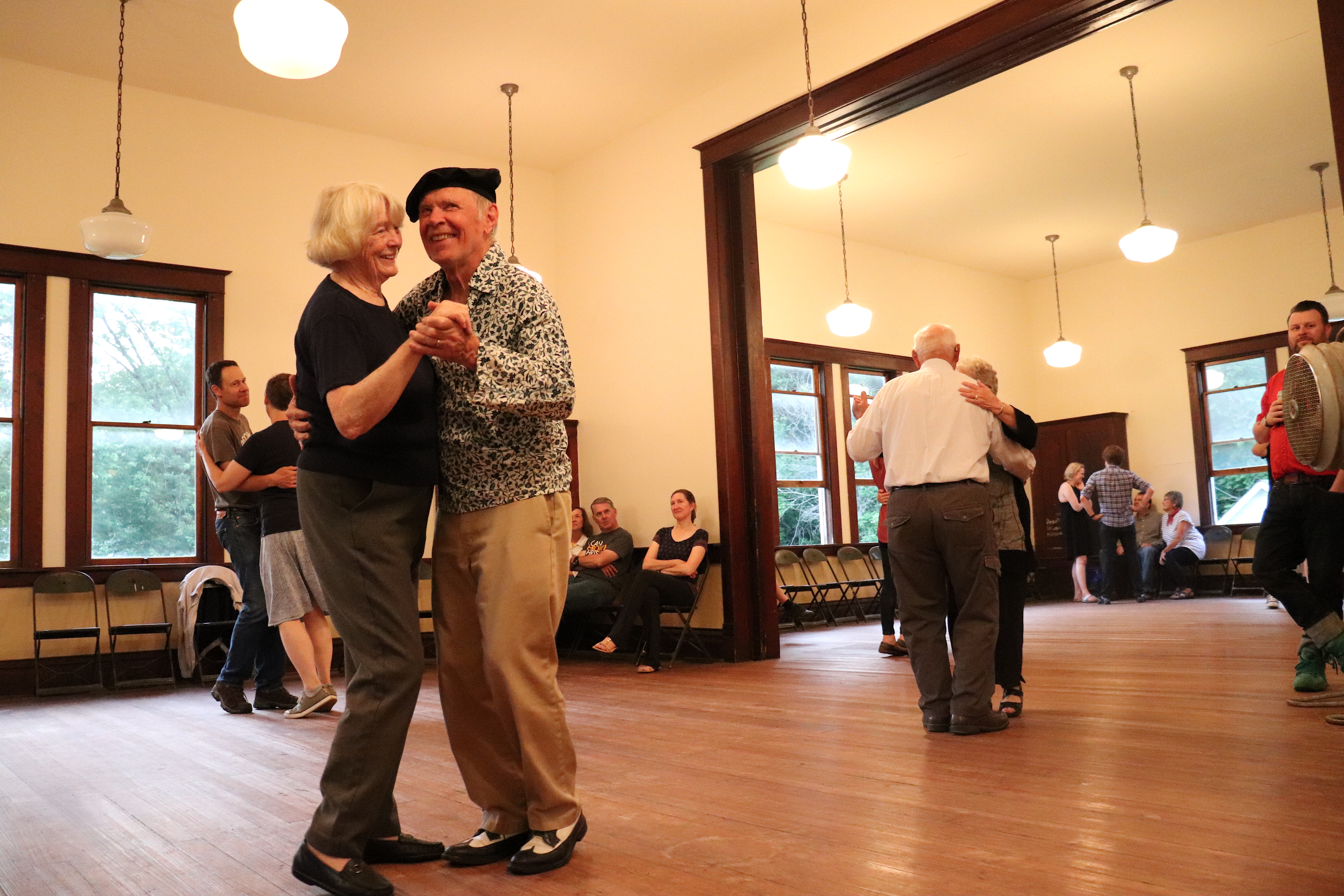 An older couple dancing to music.