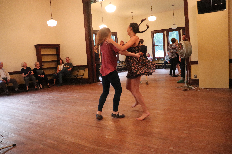Two young women dancing.