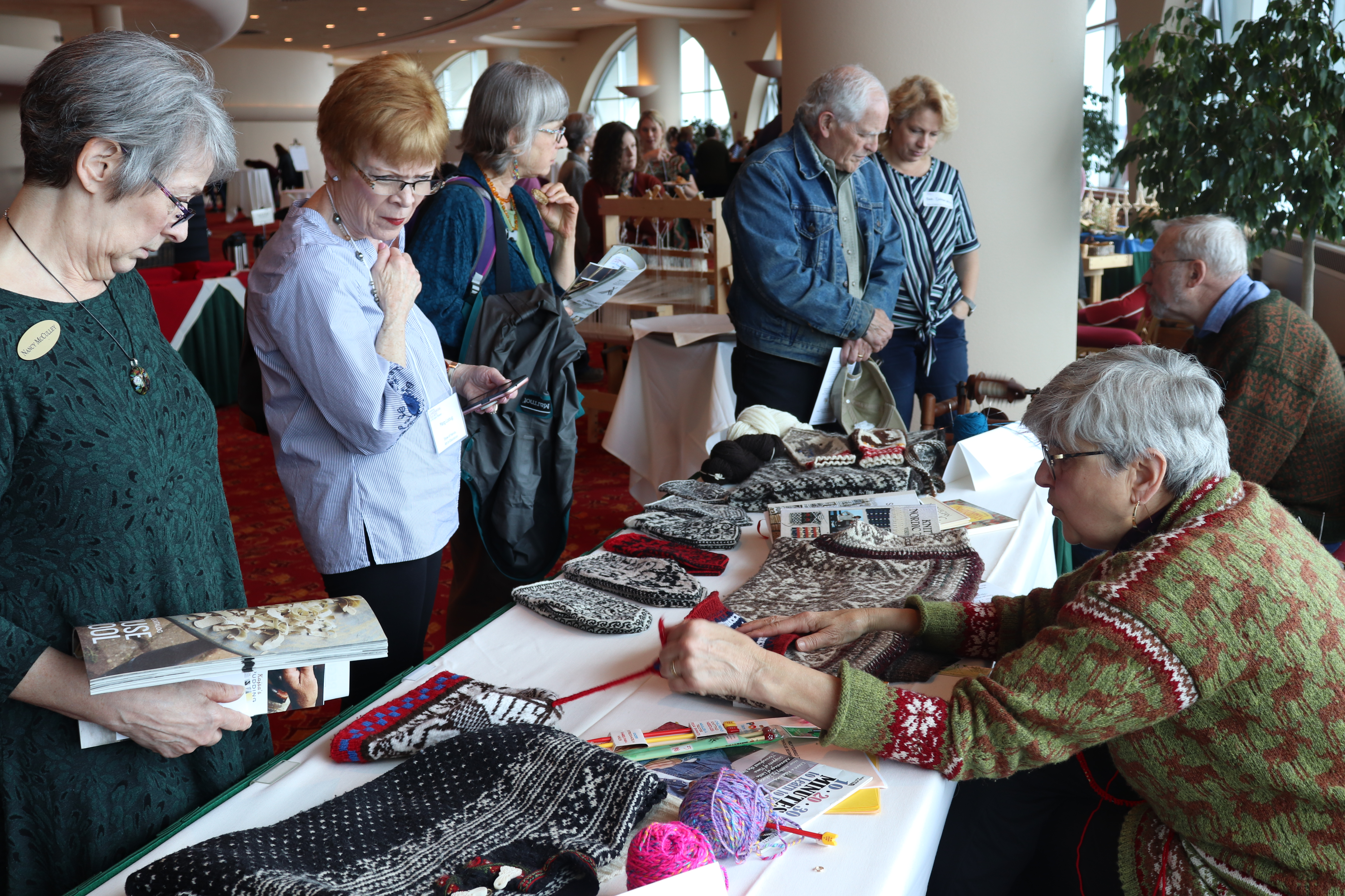 Kathryn Hartman speaks with audience members about her knitting.