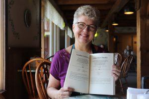 Jewel holds open cookbook
