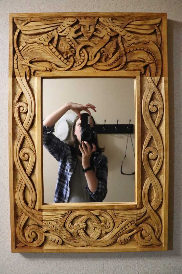 Mirror with dragon carving in frame