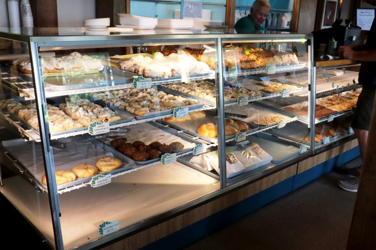 Bakery display case with baked goods inside.