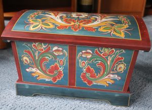 A chest painted in a Vest Agder design in blue, red, yellow, and green.